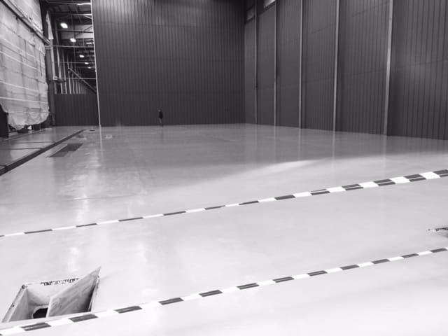 Industrial resin flooring protects this warehouse floor